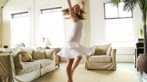 stock-footage-woman-dancing-in-living-room-with-sunflowers